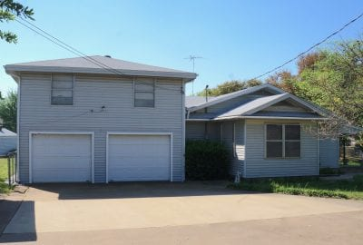 2 car attached garage with bonus room and deck above